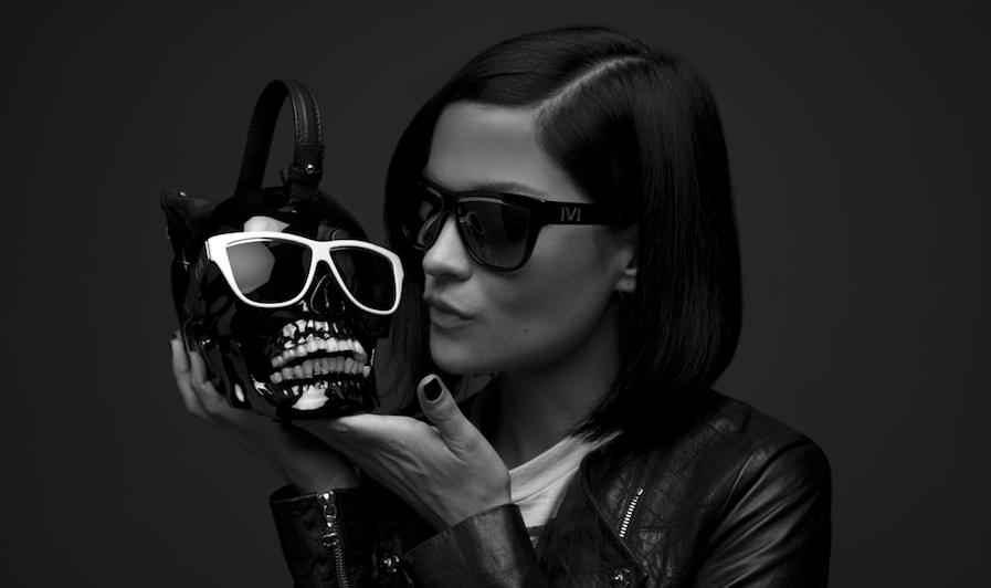 women wearing sunglasses holing a skull wearing sunglasses