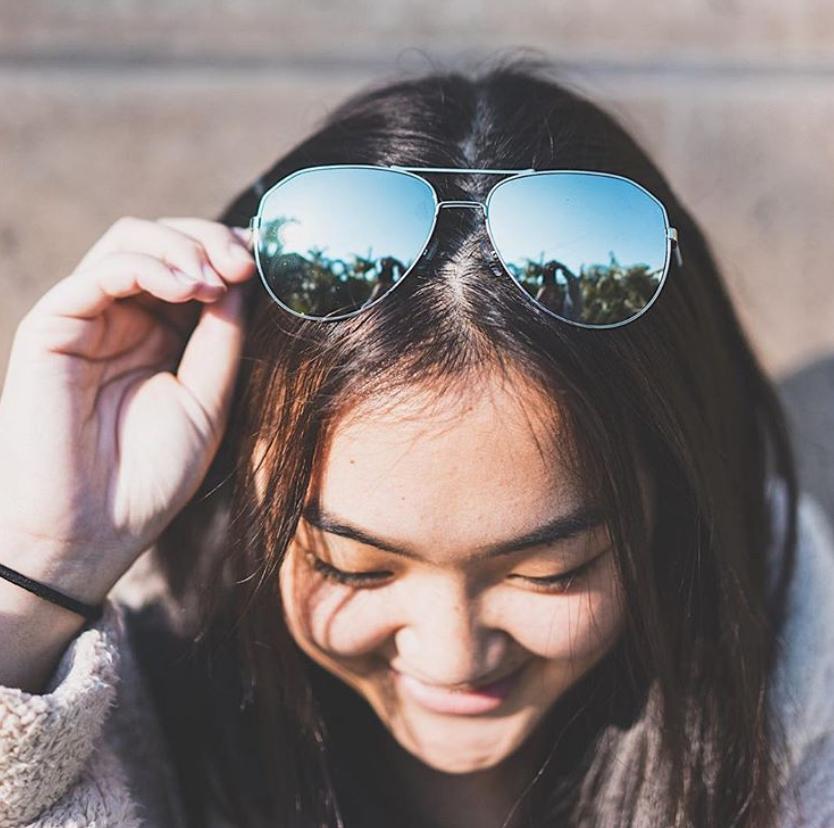 women wearing sunglasses on top of her head