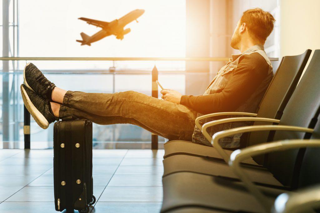 man waiting for a flight