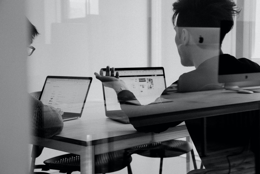 Black and white image of people in a workspace