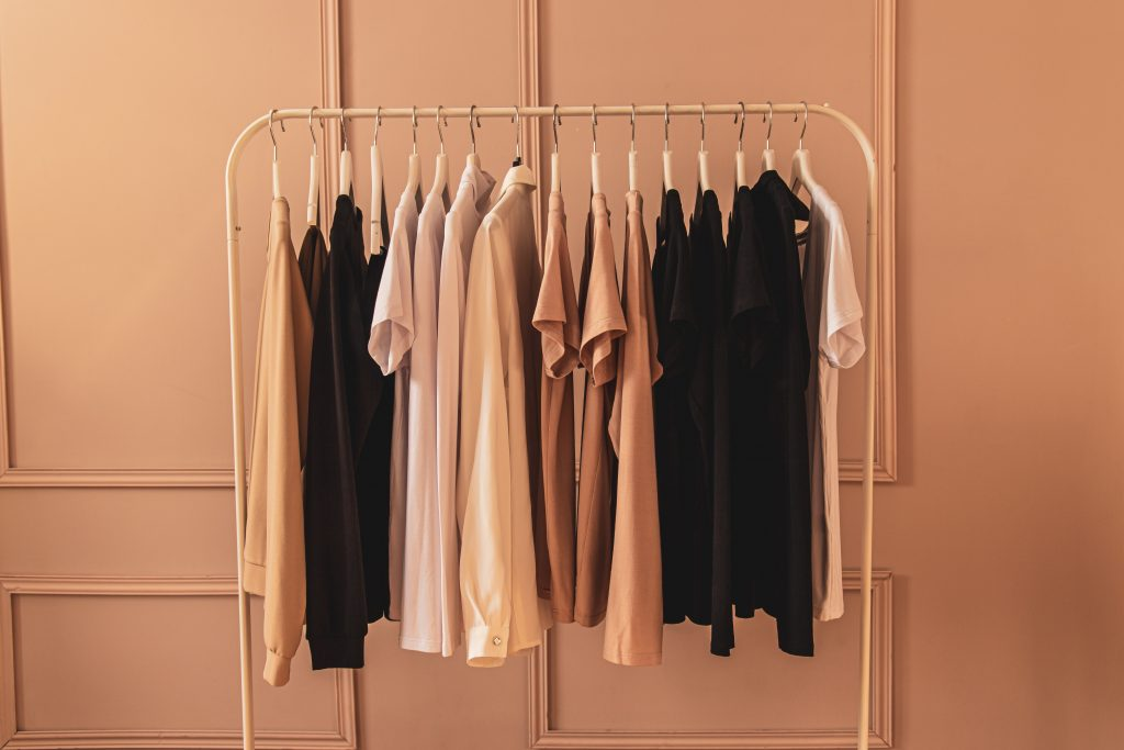 Clothing rack with T-shirts hanging.